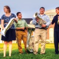 Ohio University students Simon Wildman, Molly McConnell-Wildman, Angelo Sylvester, Jeff Barbee, Nathan Cain and Professor Jason Smith tackle the tuba. (Robb DeCamp)