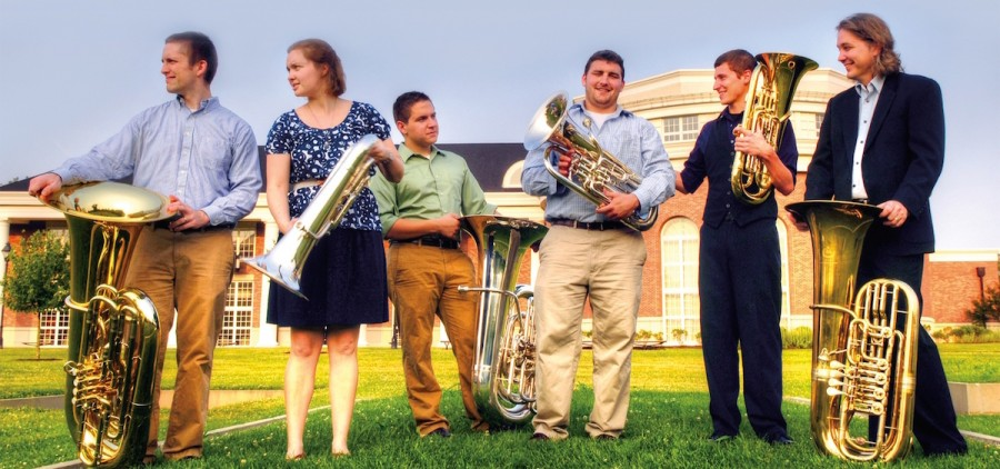 Ohio University students Simon Wildman, Molly McConnell-Wildman, Angelo Sylvester, Jeff Barbee, Nathan Cain and Professor Jason Smith tackle the tuba. (Robb DeCamp)