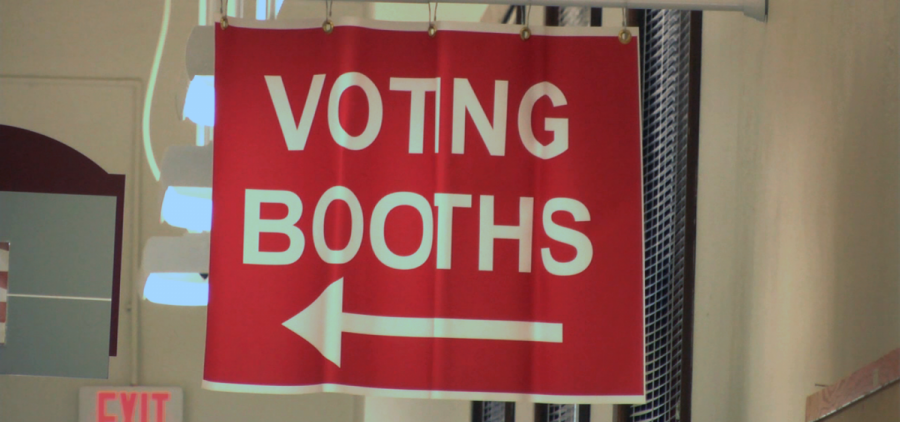 A sign for voting booths