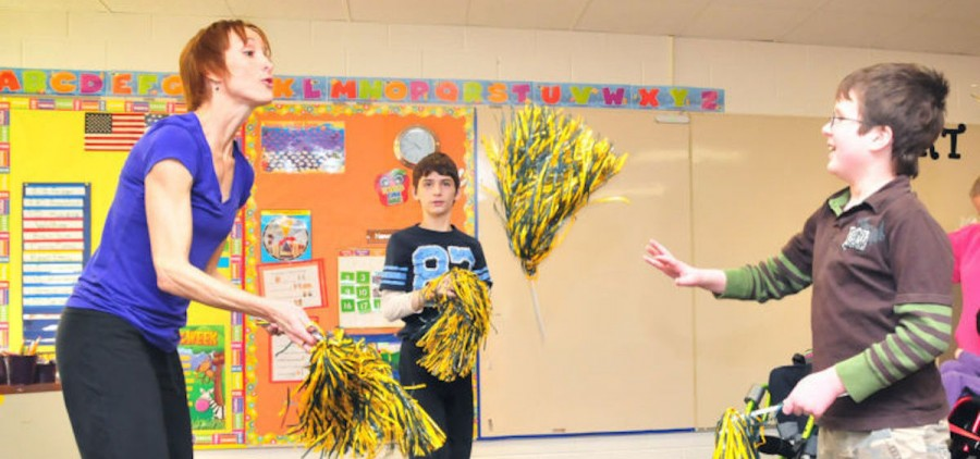 Teacher Lisa Moulton and students Jared West and Jacob Barnhart perform a movement to portray falling leaves (photo: John Halley/Athens Messenger)
