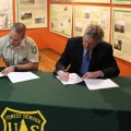 Wayne National Forest Supervisor Tony Scardina and AACA Board President Ed Pauley sign a partnership agreement between the two organizations (photo: Bryan Gibson/WOUB)