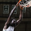 Ohio University basketball player Maurice Ndour with a slam dunk