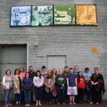 """The """"Four Seasons of Active Life in the Hocking Hills"""" artwork was unveiled on April 16 in Logan, Ohio. It hangs on the exterior rear wall of North Fitness Center and Maya Burrito Company. (Janey Savings/Logan Daily News)"""