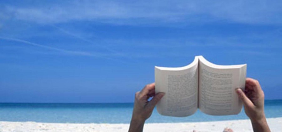 Book on beach (library.gsu.edu)