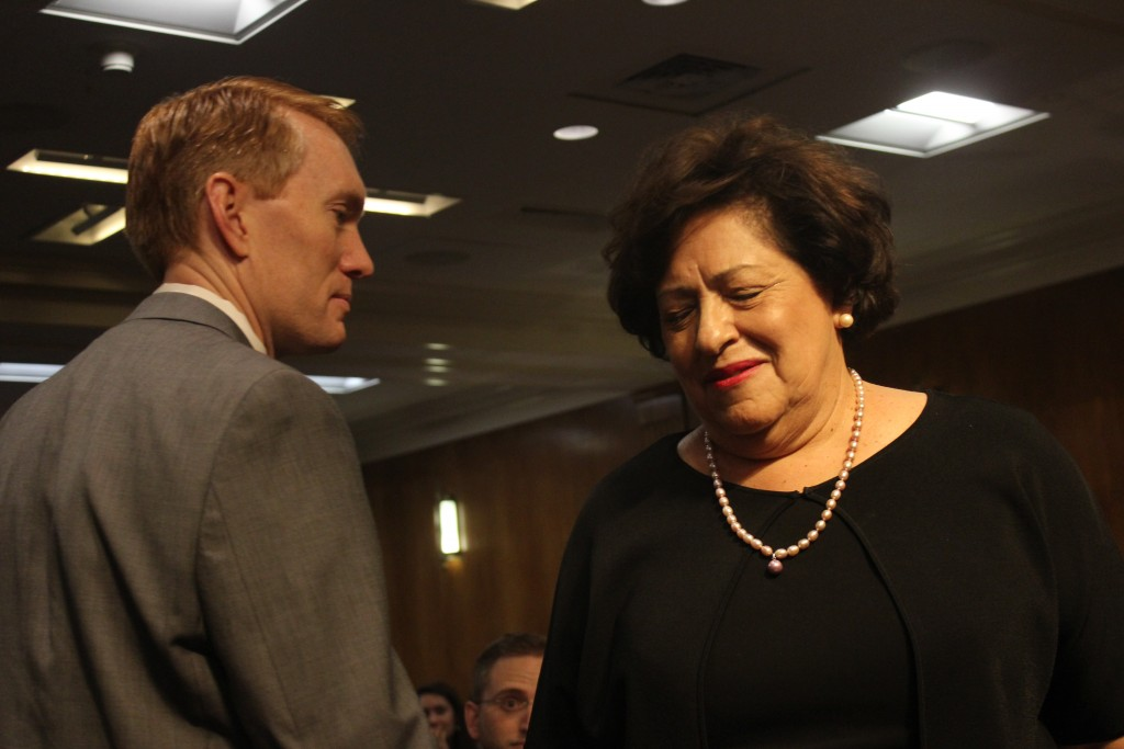 Sen. James Lankford, R-Okla., greets OPM Director Katherine Archuleta before a hearing about OPM's data security Tuesday. (Matthew J. Connor)