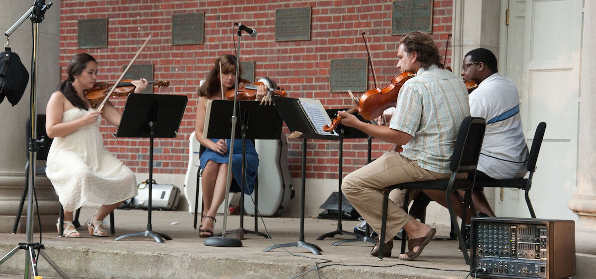 """Mozart on the Green"" musicians perform at an outdoor concert at Ohio University. The annual festival returns June 15. (Ohio University)"
