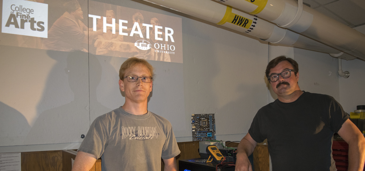 Ohio University MFA student Nathan Davis (left) and Lowell Jacobs, head of OU's Sound Design Program, inside the Sound, Projections and New Media Shop (Ohio University College of Fine Arts)