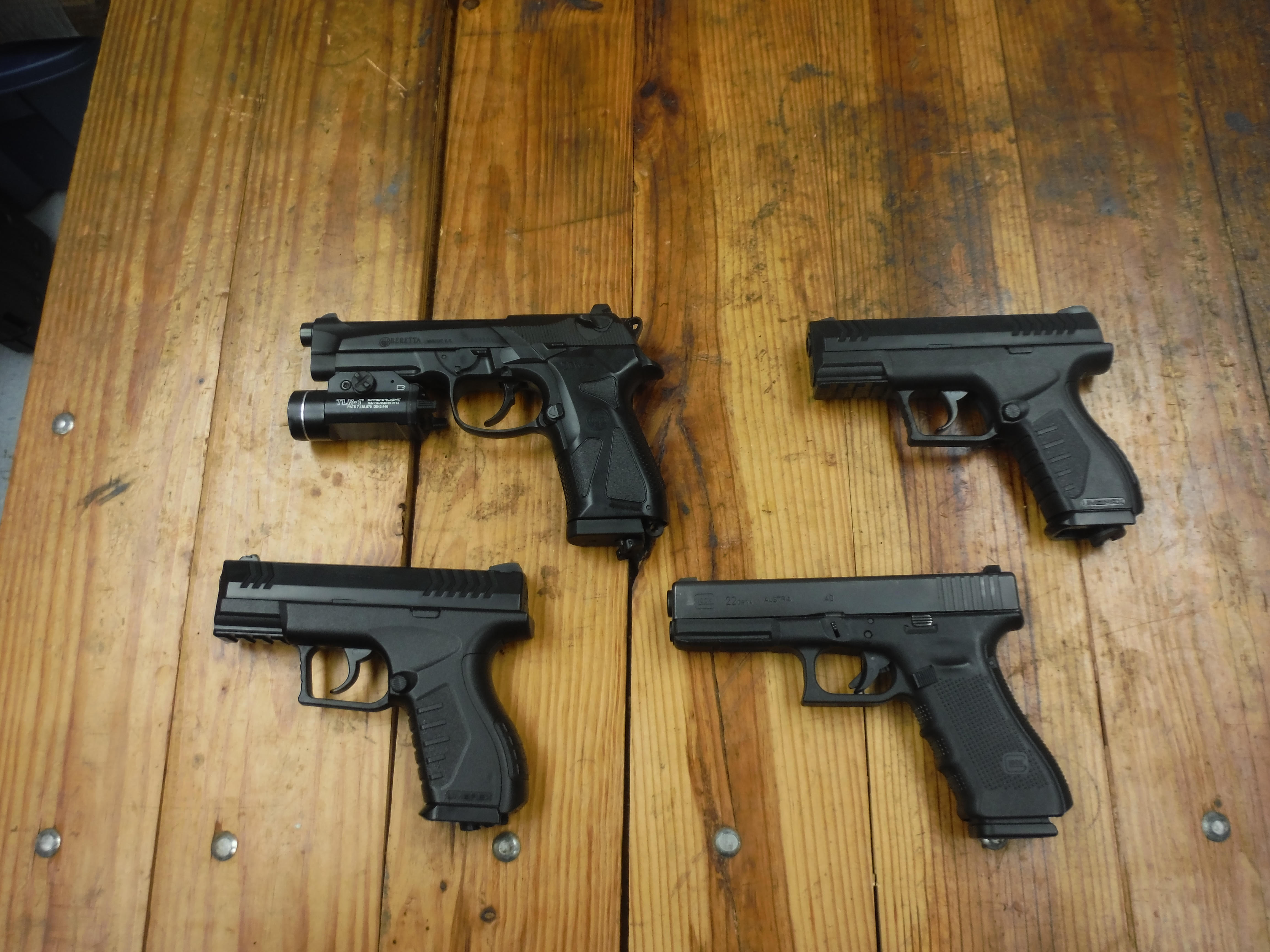 These four pistols were presented in a release by the Athens Police Department to show the similarities between an officer's service weapon (shown on the bottom right) and BB guns used by juveniles in a recent incident.