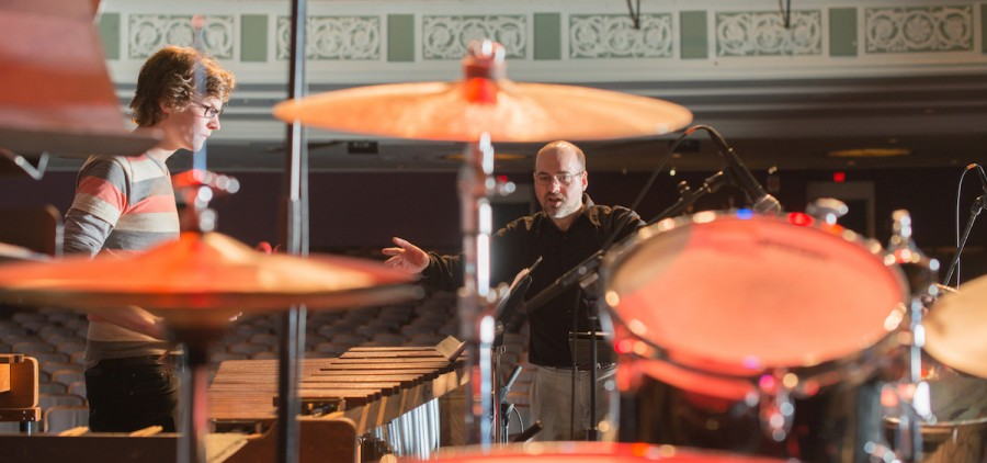 Roger Braun, center, conducts the Ohio University Percussion Jazz Ensemble during a dress rehearsal for a performance at Templeton-Blackburn Alumni Memorial Auditorium. Braun has led the university's percussion program for 15 years. (Ben Siegel/Ohio University)