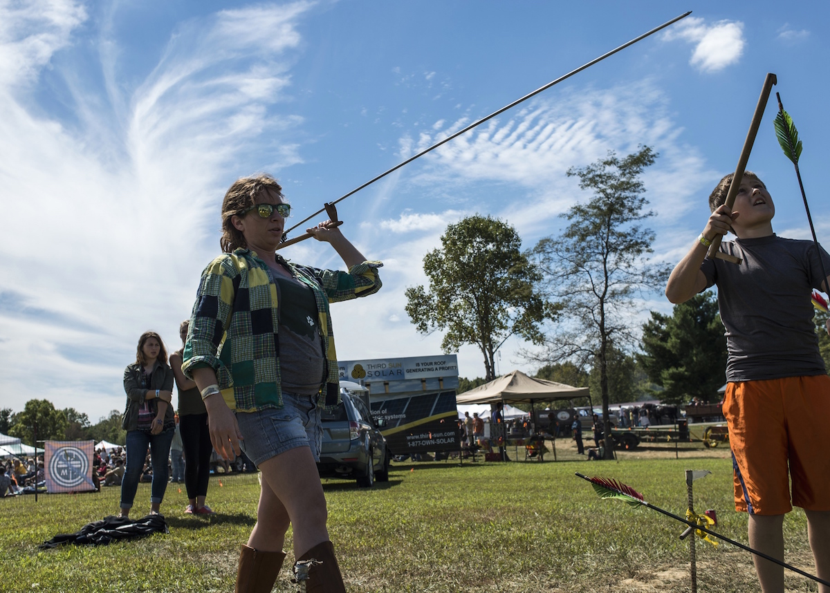 Emily Roe learns how to use an atlatl during the 2014 Ohio Pawpaw Festival. (Brooke Herbert Hayes/WOUB)