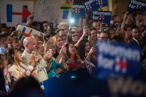 """Hillary Clinton supporters welcome Clinton on stage at the """"Women for Hillary"""" grassroots organizing meeting at the Athenaeum in Columbus, Ohio, on Thursday, Sept. 10, 2015. (Yi-Ke Peng/WOUB)"""