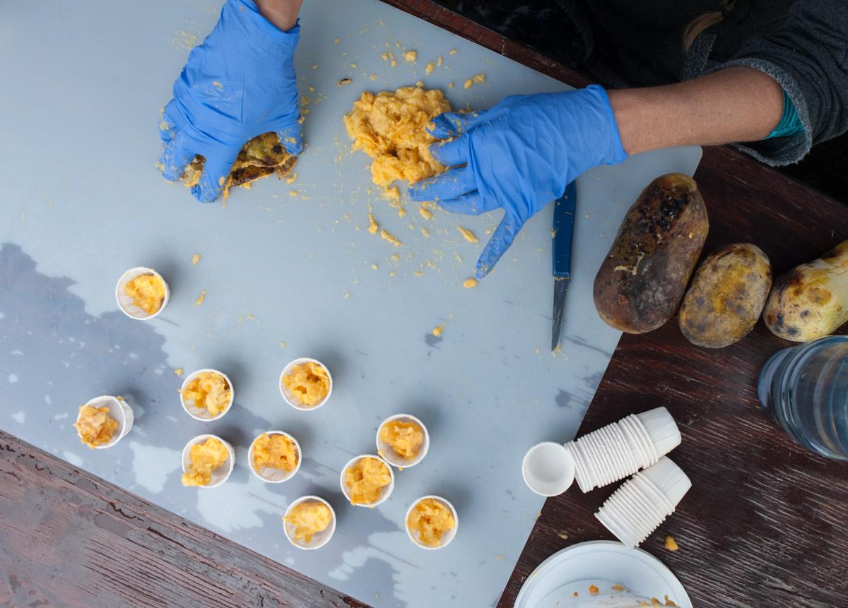 Terri Frazier of Cincinnati prepares pawpaw samples. (Yi-Ke Peng/WOUB)