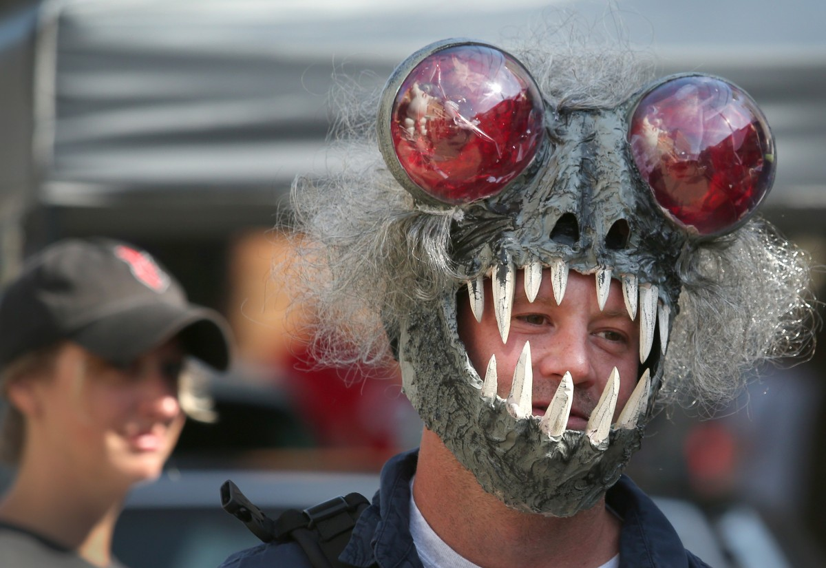 Jason Meredith of Bloomington, Ind. sported a handmade Mothman mask during his visit to Saturday's Mothman Festival in Point Pleasant, WV.