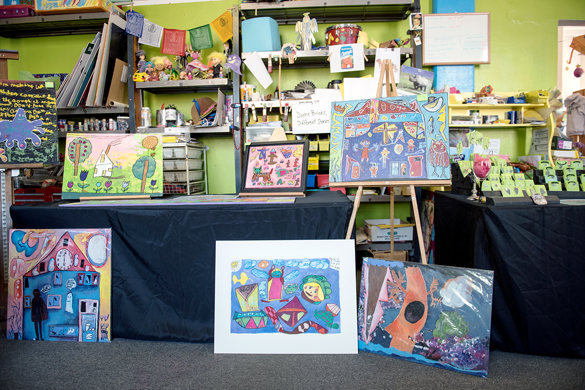 The inside of Passion Works Studio on West State Street shows art work by their clients, mostly people with disabilites that is up for sale. On Saturday, Sept. 19, 2015, Passion Works had an event where their clients came in to paint work, mostly makeshift bricks on cardboard for the Homecoming Parade later this year. (Jeffrey Zide/WOUB)