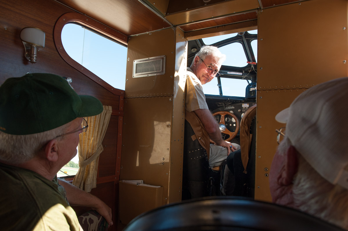 """Captain Colin Soucy talks to passengers aboard the """"Tin Goose."""" A retired Delta Airlines pilot, Soucy flies the """"Tin Goose"""" as a hobby. (Yi-Ke Peng/WOUB)"""