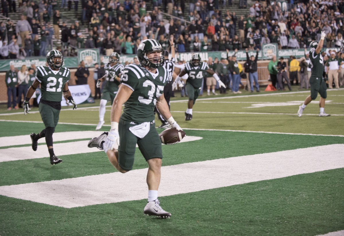 Nathan Carpenter celebrates in the end zone after returning an interception for a touchdown in the final minutes of Bobcats home opener at Peden Stadium. (Mark Clavin/WOUB)