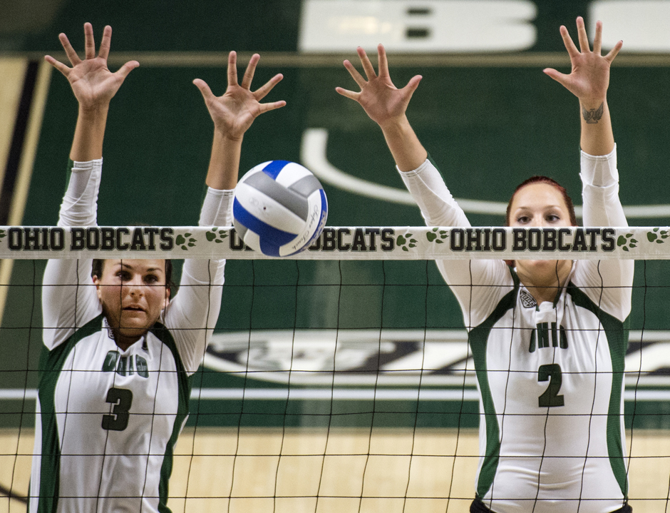 From left, Ohio University senior Abby Gilleland and redshirt freshman Katie Nelson go for the block in a game against the Xavier Muskateers at the 2015 Bobcat Inivational in the Convation Center in Athens, Ohio, on Friday, Sept. 4, 2015.  (Daniel Rader/WOUB)