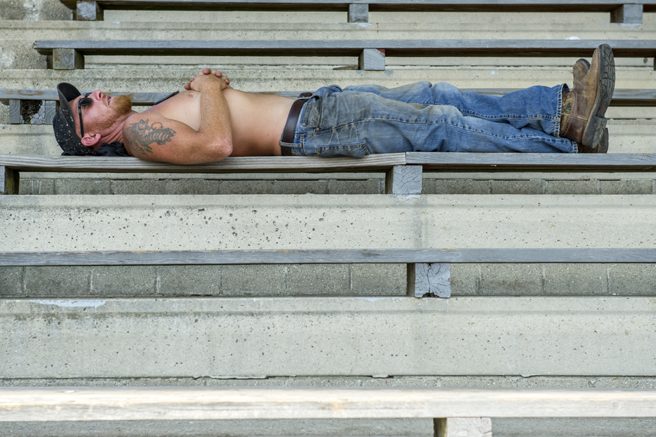 Jason Szakal of Marietta, Ohio, relaxes in the shade before the barstool races at the Easyriders Rodeo Tour at the Ross Country Fairgrounds in Chillicothe, Ohio, on Sunday, Sept. 6, 2015. (Daniel Rader/WOUB)
