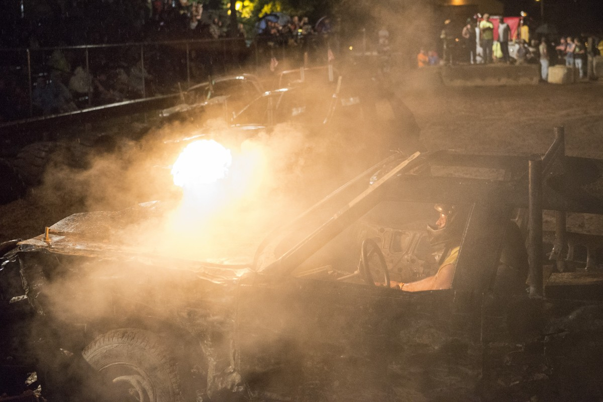 Dan Mace attempts to re-start his car so he can continue in the demolition derby at the Albany Independent Fair in Albany, Ohio on Friday, September 11, 2015.