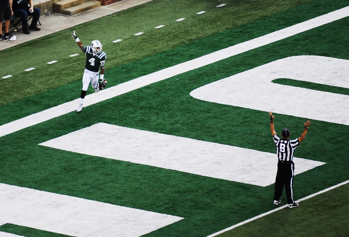 Ohio Bobcats running back Papi White (4) celebrates after a 58 yard run during their game against Southeastern Louisiana held at Peden Stadium on Sept. 19, 2015, in Athens, Ohio. (Logan Riely/ WOUB)