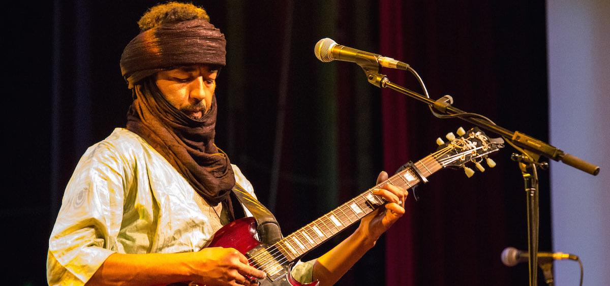 Diara, guitarist and vocalist of Terakaft, performs at Stuart's Opera House on Sept. 14, 2015. (Jasmine Beaubien/WOUB)