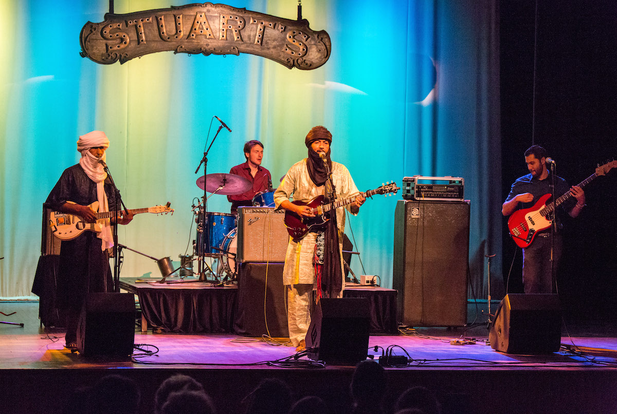 """Terakaft performs a song from their album """"Alone"""" at Stuart's Opera House. (Jasmine Beaubien/WOUB)"""