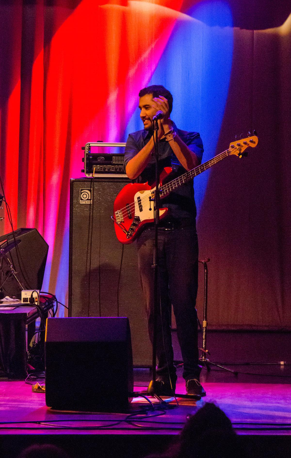 Sanou Ahmed, bassist of Terakaft, invites the audience to clap along. (Jasmine Beaubien/WOUB)