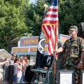 Two former veterans stand at attention during the Jacksonville Old Settlers Reunion Parade on Monday, Sept. 7, 2015 in Jacksonville, OH. The truck they were in carries plaques dedicated to troops missing in action from World War I all the way to the last Iraq War.