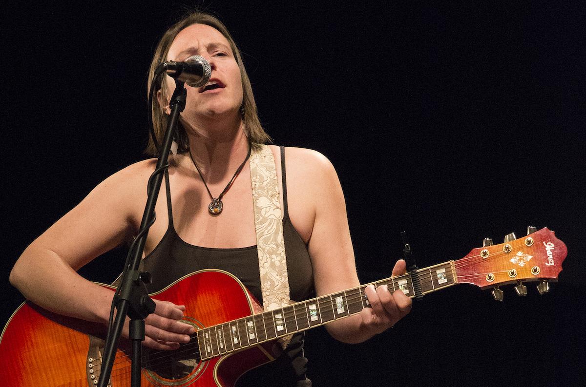 "Megan Wormz Bihn sings her original composition ""Cincinnati"" at a 2015 ""Women Speak"" event."