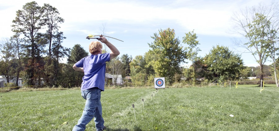 Ray Strischek of Athens, Ohio throws an atlatl at The Plains Indian Mounds Festival in Plains, Ohio on Sunday, October 4, 2015.  (Margaret Sabec/WOUB)