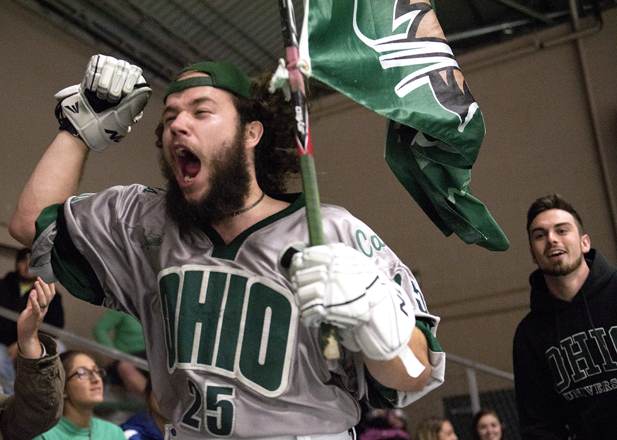 An Ohio Bobcat Hockey fan celebrates after the Bobcats score a goal against West Virginia University on Friday, Oct. 2, 2015 at the Bird Arena at Ohio Unversity in Athens, Ohio. The Ohio Bobcats defeated West Virginia University by a score of 8-1 as the continue to be undefeated with a record of 5—0—0. (Jeffrey Zide / WOUB)