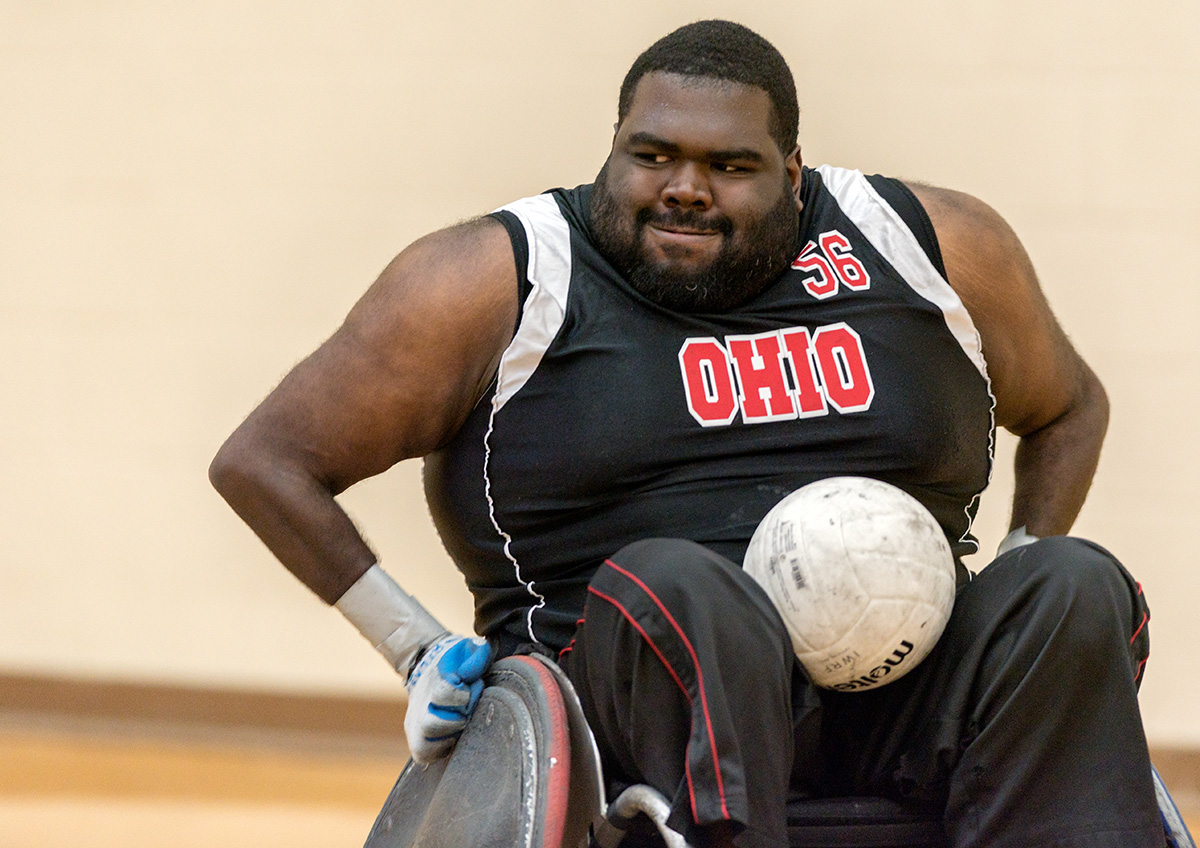 #56 Jermey Edgar steers the ball towards the goal line at the Quad Rugby tournament at the Ping Center in Athens, Ohio on October 3, 2015. Quad Rugby is rugby for Quadrplegics, who are people who are paralzyed for the waist down. The Ohio Buckeyes team is part of the US Quadriplegic Rugby Association or USQRA for short. (Jeffrey Zide / WOUB)