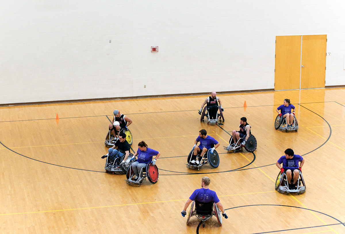 Members of the Quad Rugby team from Columbus Ohio play against students and volunteers from Ohio University at the Ping Recreation Center in Athens, Ohio on Oct. 3, 2015. (Jeffrey Zide / WOUB)