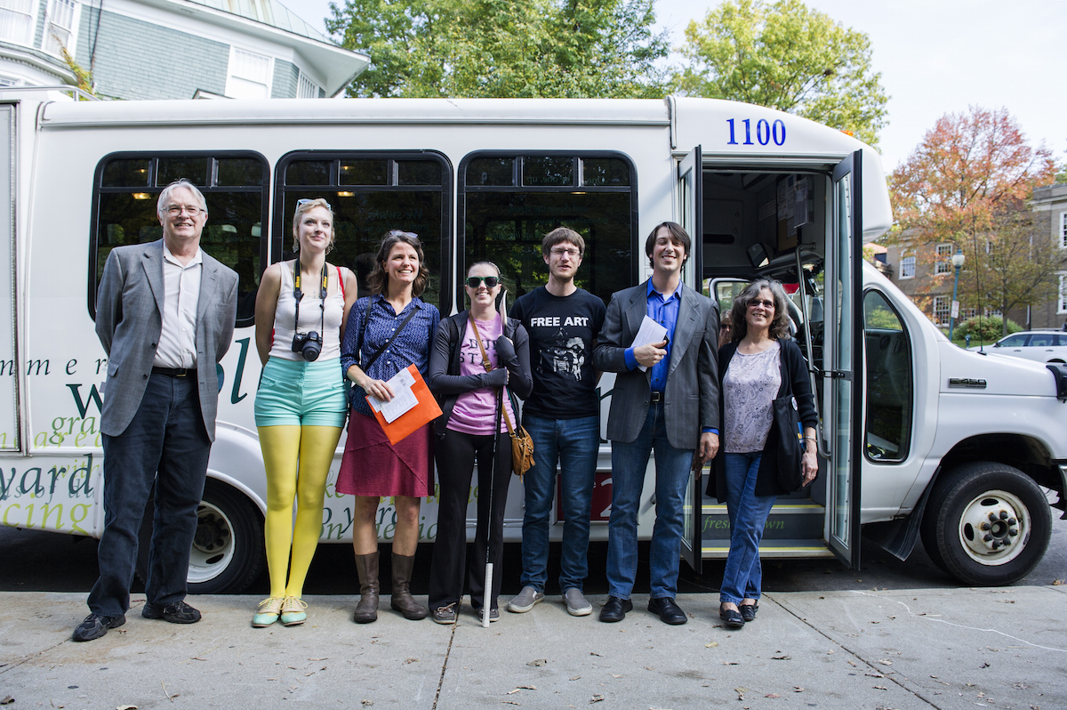 From left, Athens Mayor Paul Wiehl, Misty Thomas-Trout, Molly Schoenhoff, Kelsey Hanson, Nathaniel Berger, Athens Public Transit Manager Michael Lachman, Wendy McVicker (Daniel Rader/WOUB)