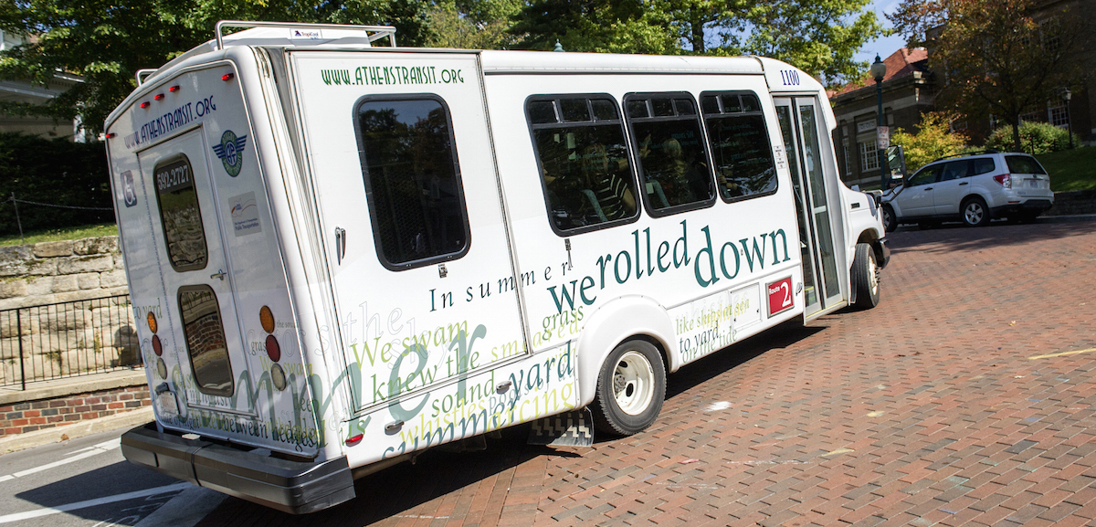 "Athens Public Transit's new "" On the Bus"" features a typographic interpretation of poet Wendy McVicker's poem ""In Summer."" (Daniel Rader/WOUB)"