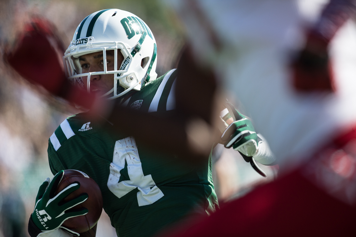 Ohio redshirt freshman running back Papi White (#4) carries the ball for a 36 yard gain against OU's rival Miami University on Saturday, Oct. 10,2015 at Peden Stadium in Athens, Ohio. White had a career-high 75 receiving yards. The Bobcats defeated the Red Hawks 34-3 on homecoming weekend.