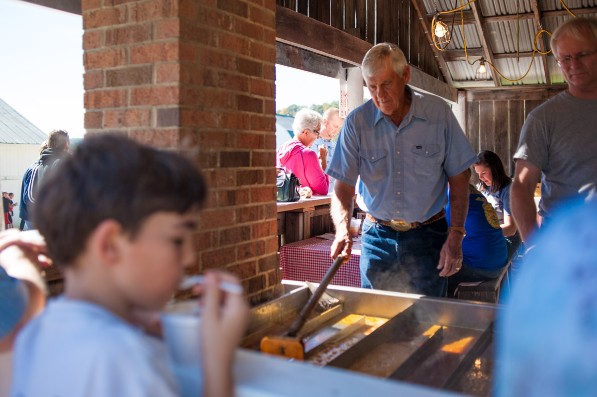 Marlin Baker of Gallia County, Ohio, cooks a batch of sorghum syrup at the 45th annual Bob Evans Farm Festival at the Bob Evans Farm in Rio Grande, Ohio, on Sunday, Oct. 11, 2015. (Yi-Ke Peng/WOUB)