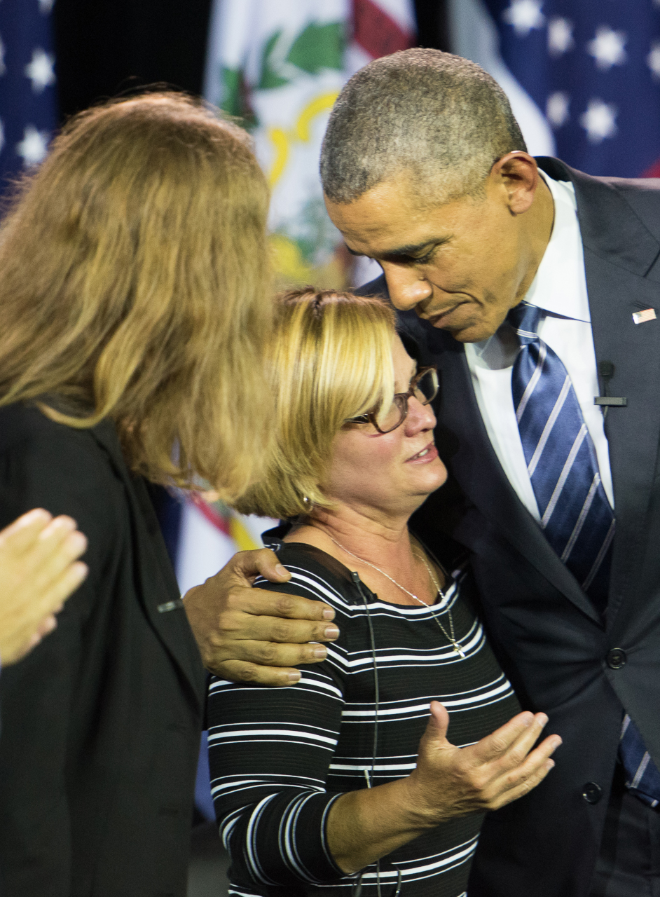 President Obama hugs Cary Dixon, whose son had been incarcerated for drug use,  at the end of the forum.