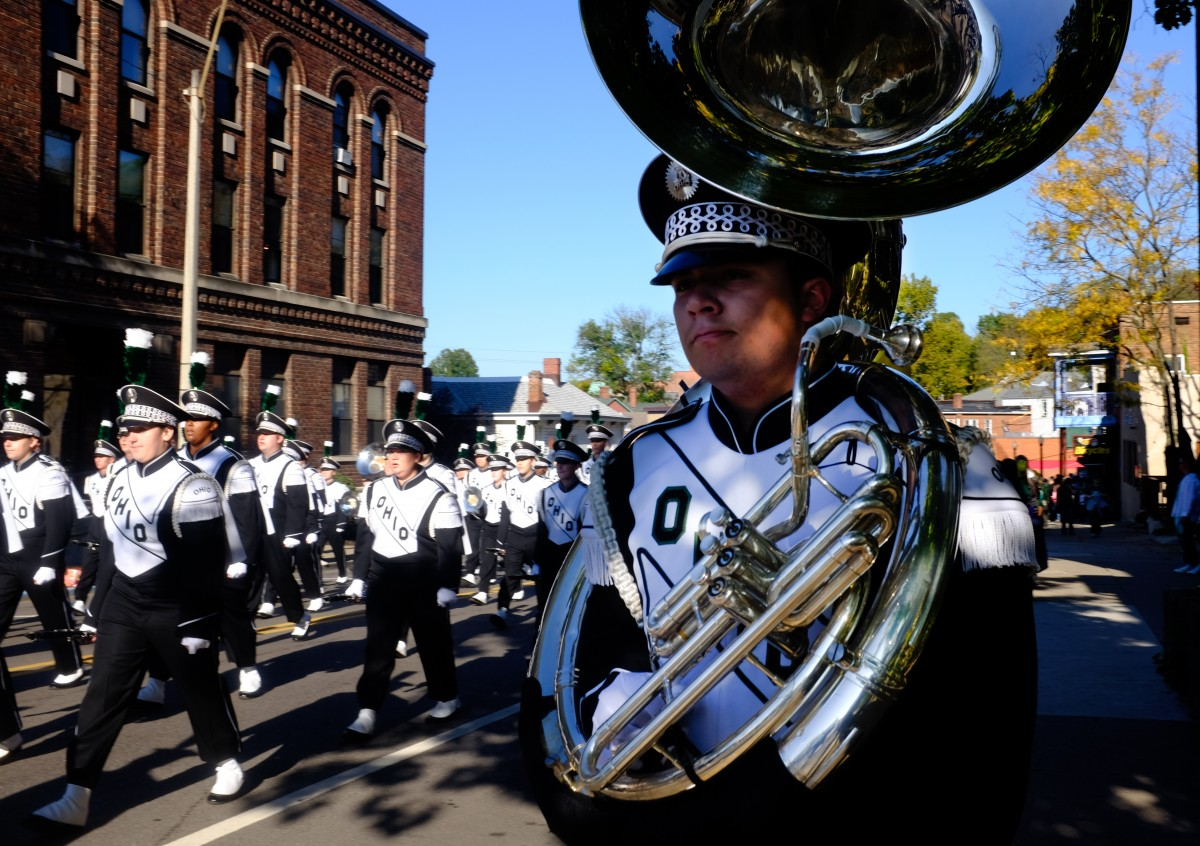Members of the Ohio University Marching 110 make their way up Union St. during the Homecoming parade on Saturday, Oct. 10, 2014. (Mark Clavin/WOUB)