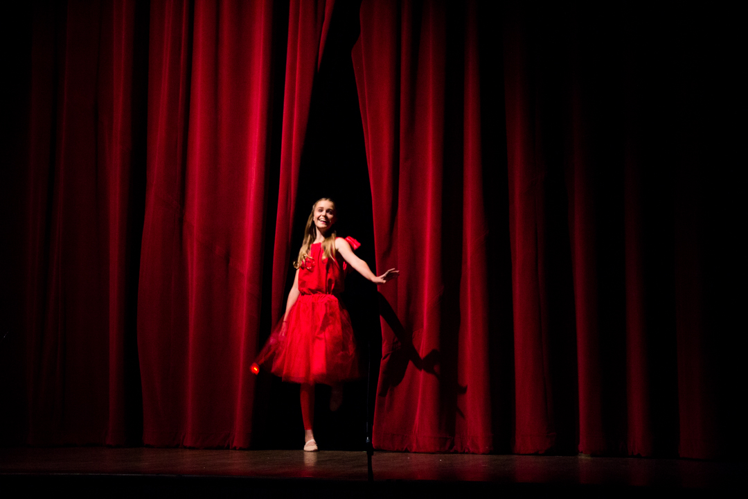 """Annie Haseley, starring as Rosa in """"My Son, Pinocchio,"""" steps out from behind the curtain as the show opens at the Stuart Opera House in Nelsonville, Ohio, October 15th.  (Hannah Schroeder/WOUB)"""