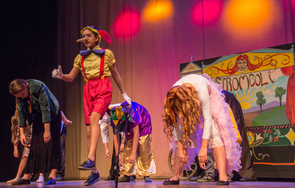 Pinocchio (Allyriane Huq) dances alongside other marionettes after leaving his father, Geppetto. (Hannah Schroeder/WOUB)