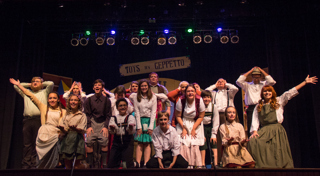 """The cast for """"Pinocchio, My Son"""" poses together after a long scene in Geppetto's workshop. The show opened Thursday at the Stuart Opera House in Nelsonville, Ohio. (Hannah Schroeder/ WOUB)"""
