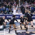 The Ohio University women's volleyball team celebrates after scoring the final point against Northern Illinois to become the 2015 MAC Volleyball Champions at the Convocation Center in Athens, Ohio, on Sunday, Nov. 22, 2015.
