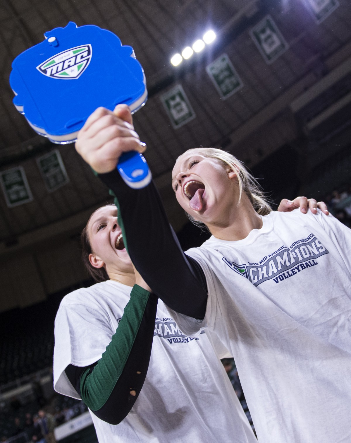 Ohio University junior Mallory Salis and redshirt junior Aubree Hord celebrate after Ohio University defeated Northern Illinois to become the 2015 MAC Volleyball Champions at the Convocation Center in Athens, Ohio, on Sunday, Nov. 22, 2015.