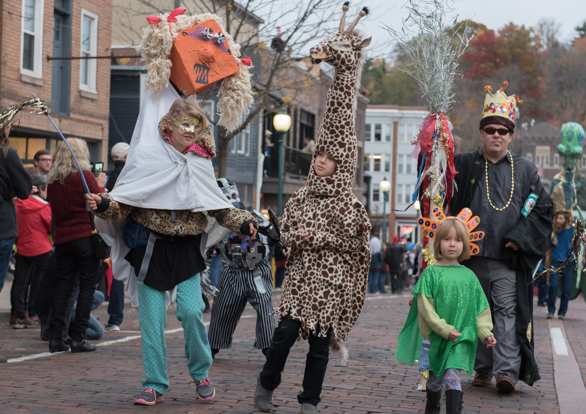 William Deluy(far right) of Athens, Ohio, the Grand Marshall of the Honey for the Heart Parade, walks down Court and Carpenter Street with parade goers at the Honey for the Heart parade on Halloween Night, Saturday, Oct. 31, 2015 (Jeffrey Zide / WOUB)