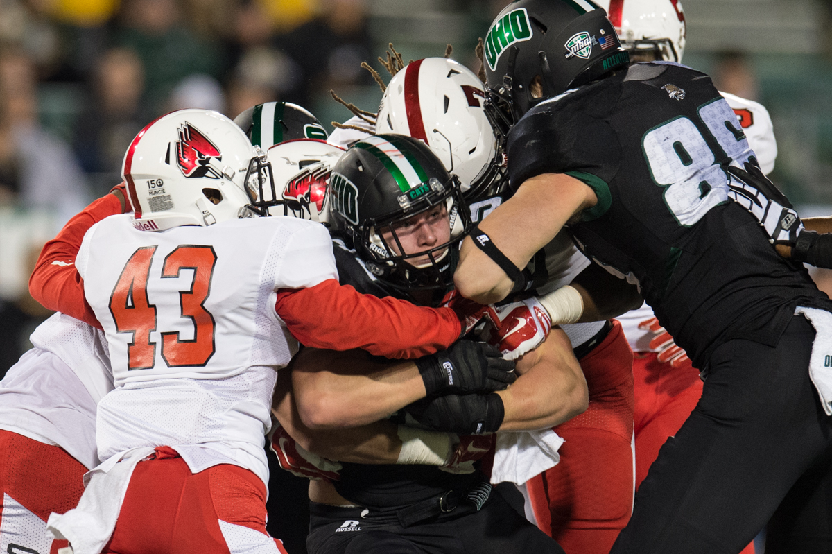 OU Sophomore running back  A.J. Ouellette (#45 ) tries to hold off the Ball State defense at Peden Stadium in Athens, Ohio on Tuesday, Nov. 17, 2015. Ouellette had the most rushing yards by a single player this year with 121 during the Senior Night victory. (Nicole Raucheisen/WOUB)