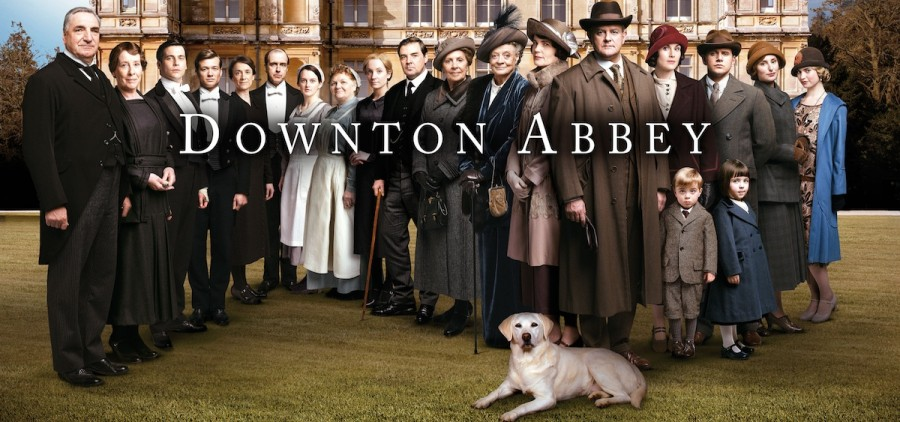 Downton Abbey stars in front of castle