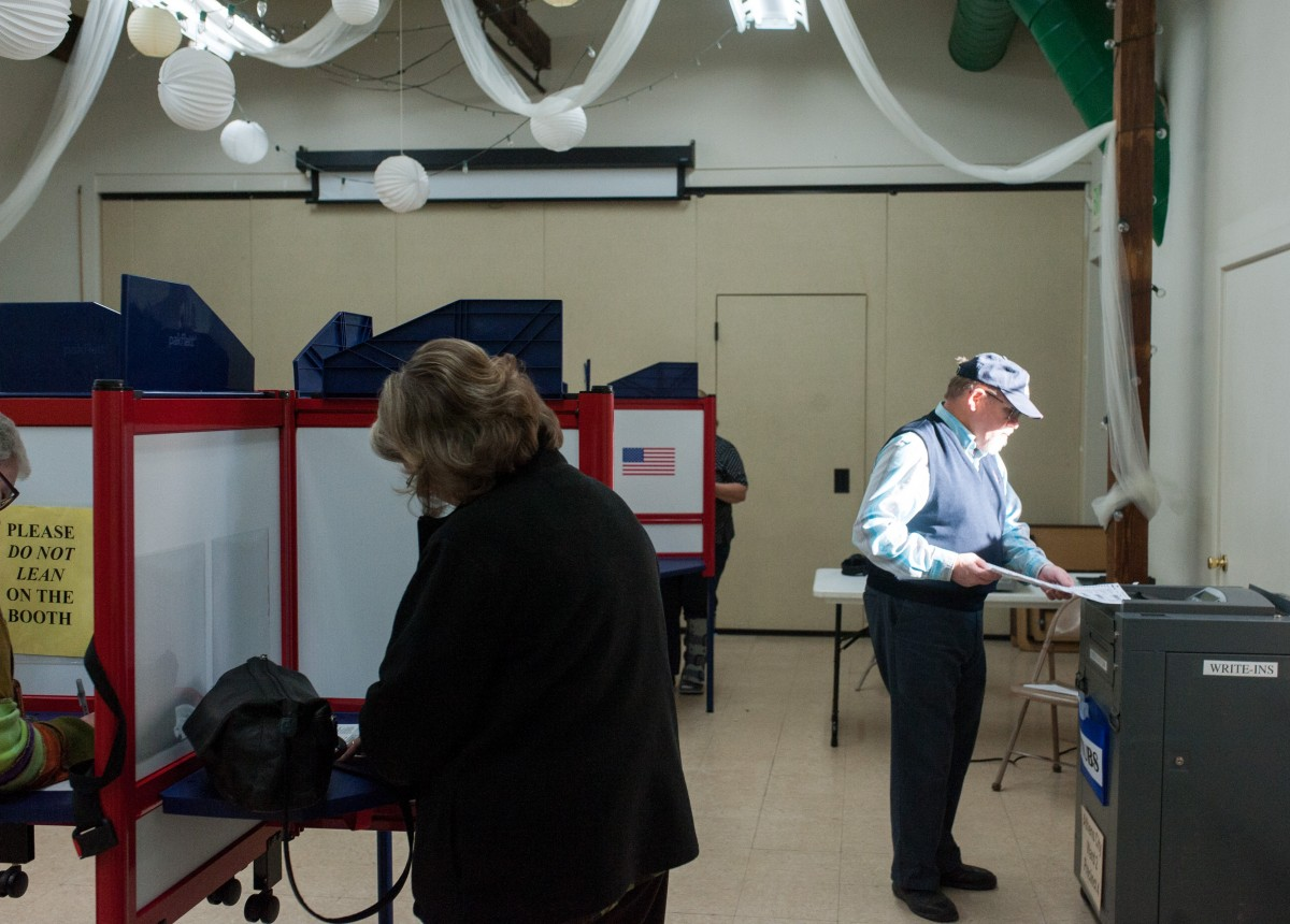 Fred Tom files his ballot after voting at the Dairy Barn Arts Center on Nov. 3, 2015. (Mark Clavin/WOUB)