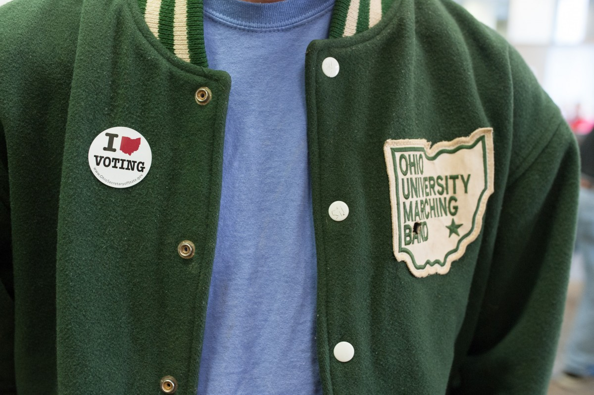 Ohio University Sophomore Gregory Curran places his sticker on his chest after voting in the Jefferson Hall Library on Ohio University's main campus in Athens, Ohio, on Nov. 3, 2015. (Mark Clavin/WOUB)