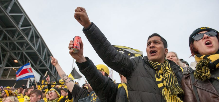 Fans inside MAPFRE Stadium cheer on the Columbus Crew while they warm up.